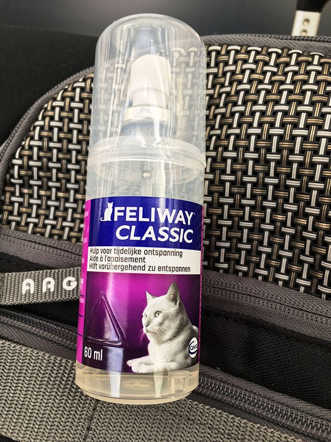 Feliway spray, an essential item for traveling with a cat on an international flight. #travel #cats #pettravel