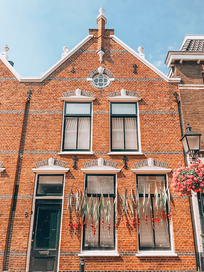 Beautiful home exterior in Holland.  Read tips for buying a home in the Netherlands for expats! #expat