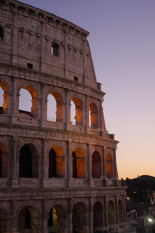 Beautiful view of the Coliseum in Rome at sunset.  This self-guided walking tour of Rome shows you the best that Rome has to offer by taking you away from the crowds! #rome #italy #travel #roma #italia