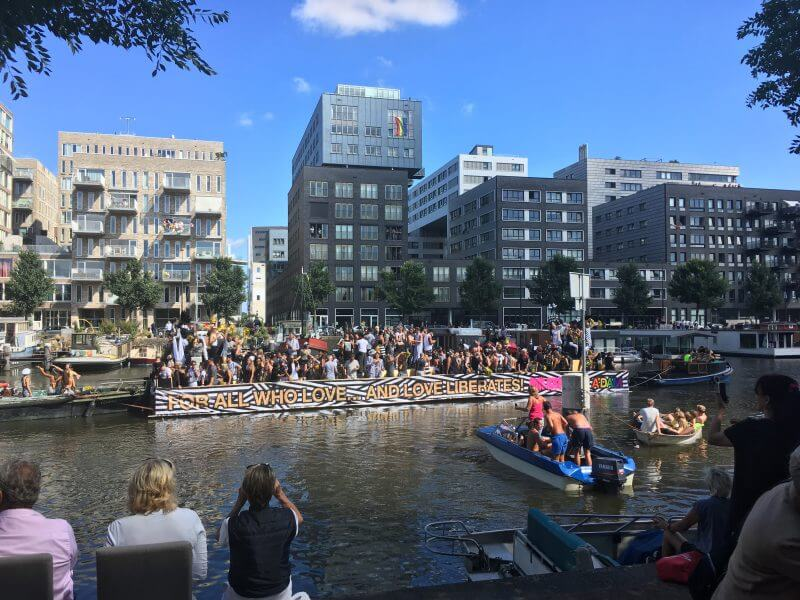 Modern scene on Pride in Amsterdam showing off modern rentals in Amsterdam.  Read how to find a flat in Amsterdam for expats!