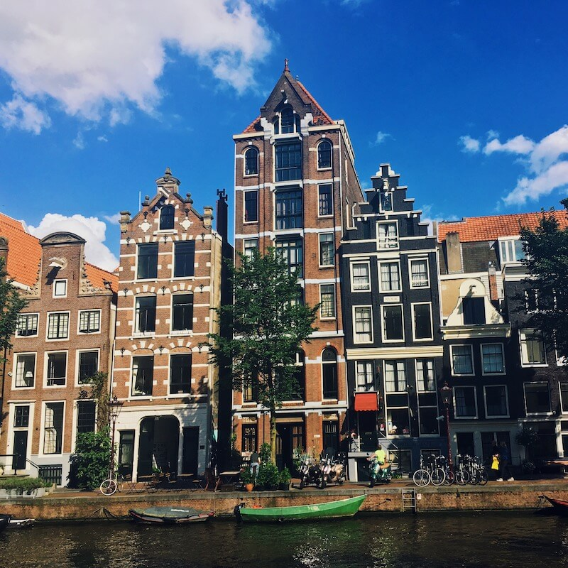 Beautiful canal houses in Amsterdam.  Read how to find the perfect apartment in Amsterdam for expats in this guide to renting in Amsterdam!