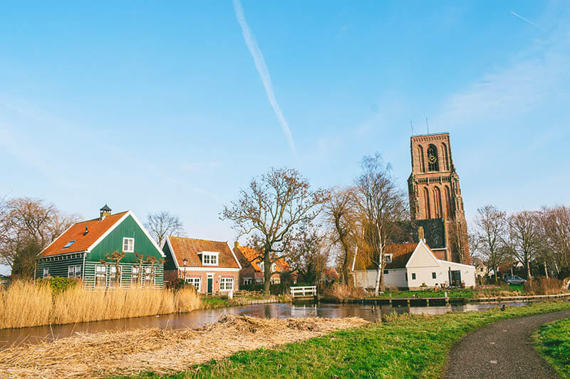 View of Ransdorp, including the Tower of Ransdorp. This cute village in Amsterdam is surrounded by fields!  #amsterdam #holland