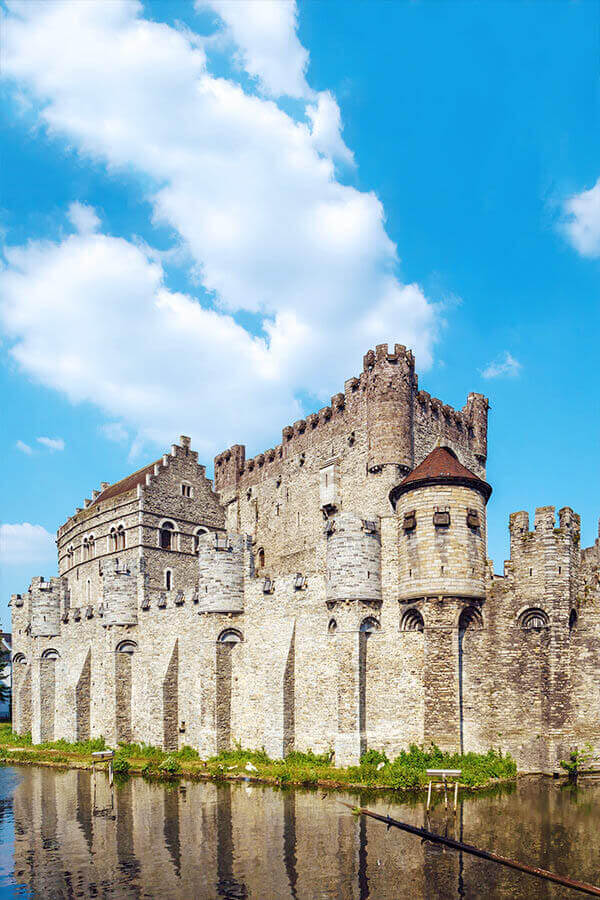 Gravensteen castle is one the highlights of visiting Belgium for the first time. See your perfect Belgian itinerary! #travel #belgium #ghent #gent