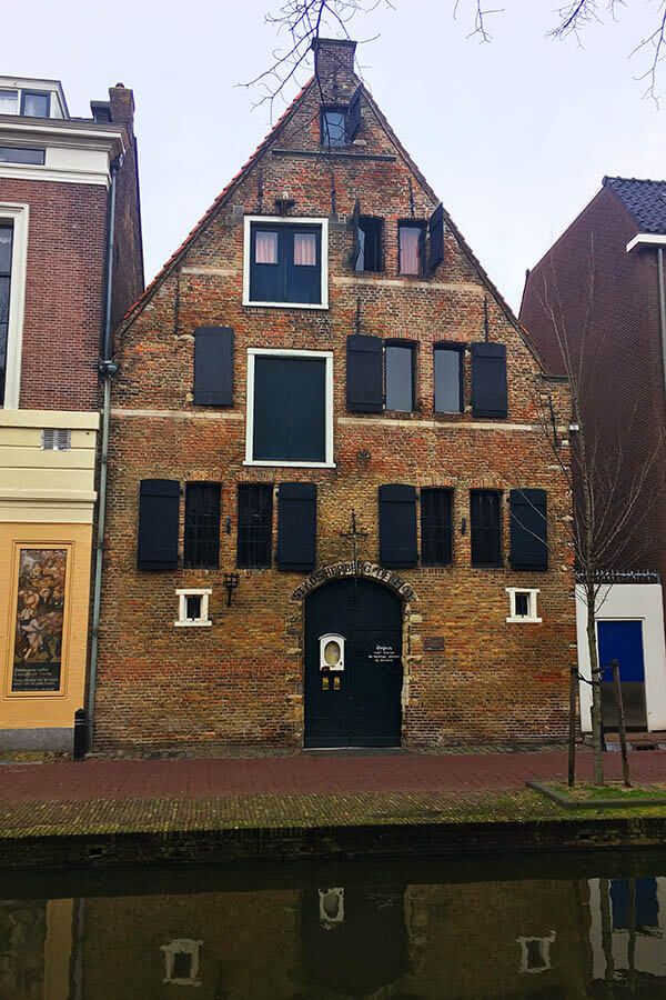 Stadsherberg De Mol is within the oldest buildings in Delft.  This building is definitely a secret spot beloved by locals and it's  home to a quirky medieval themed restaurant. #travel #delft #holland #netherlands #nederland