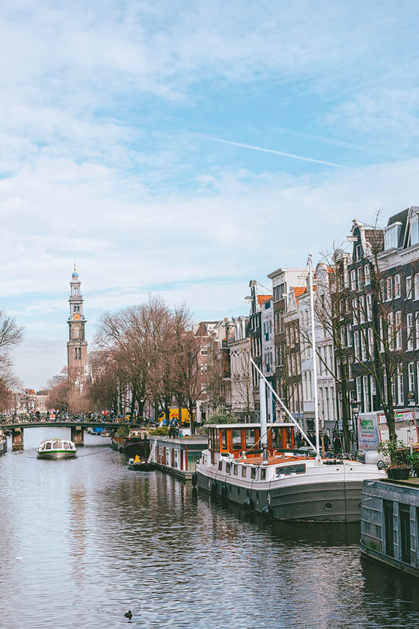 Beautiful photo of Amsterdam.  Read what it's like to travel to Amsterdam as a solo female traveler with tips from a resident. #travel #amsterdam #holland #netherlands #nederland