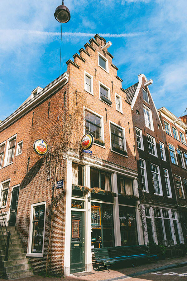 Exterior of Cafe Chris, one of Amsterdam's oldest cafes.  This classic Dutch bar is one of the best places to experience Amsterdam unfiltered! #amsterdam #holland #netherlands #nederland #bruinbar