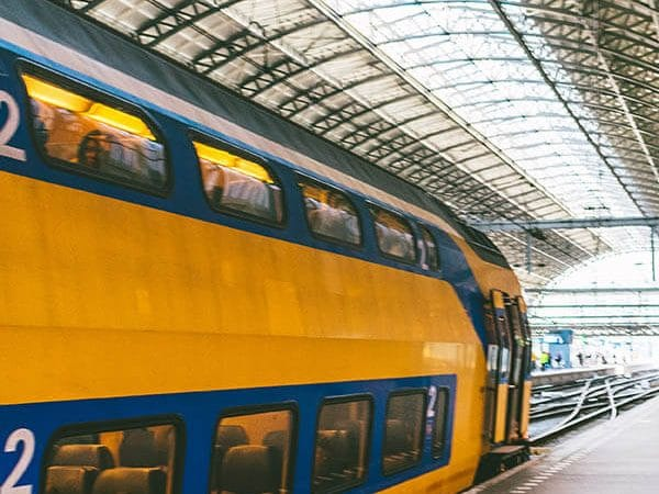 Train departing from Amsterdam Centraal en route to Schiphol Airport. Read how to get to Schiphol Airport from Amsterdam City! #travel #amsterdam #schiphol