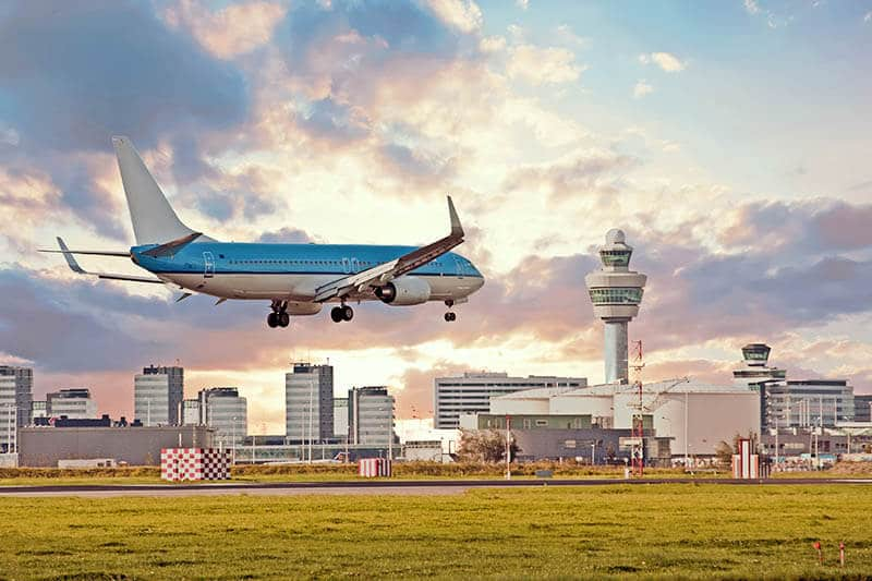 Plane landing at Schiphol Airport, the best way to get to Amsterdam!