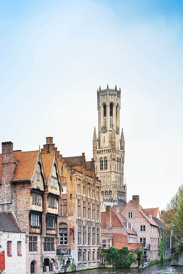 Beautiful view of a canal in Bruges, one of the highlights of a first-time Belgian itinerary! #travel #belgium #bruges
