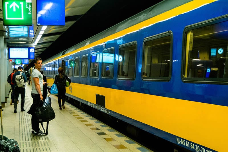 Man waiting for a train to Amsterdam Centraal at Schiphol Airport.  It's very easy to travel from Schiphol to Amsterdam!