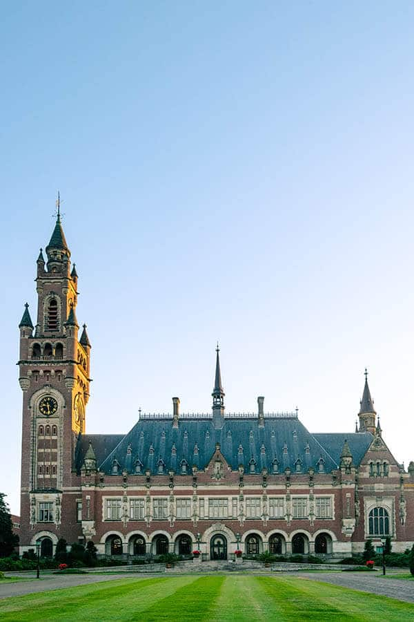Beautiful photo of the Peace Palace in the Hague. Viewing the Peace Palace and visiting the free visitor's centre is one of the best free things to do in the Hague! #travel #holland #hague #denhaag #netherlands #nederland