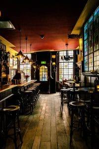 Interior of De Vergulde Kruik, a charming brown bar in Leiden worth visiting. This charming Dutch cafe in Leiden is where the Heineken Star originated from! #travel #leiden #heineken #holland #beer #nederland #netherlands