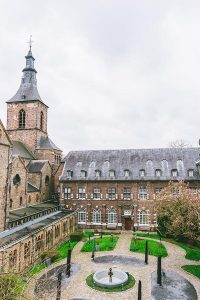 Photo of Abdij Rolduc, an abbey hotel in the Netherlands near Aachen, with a picturesque courtyard.
