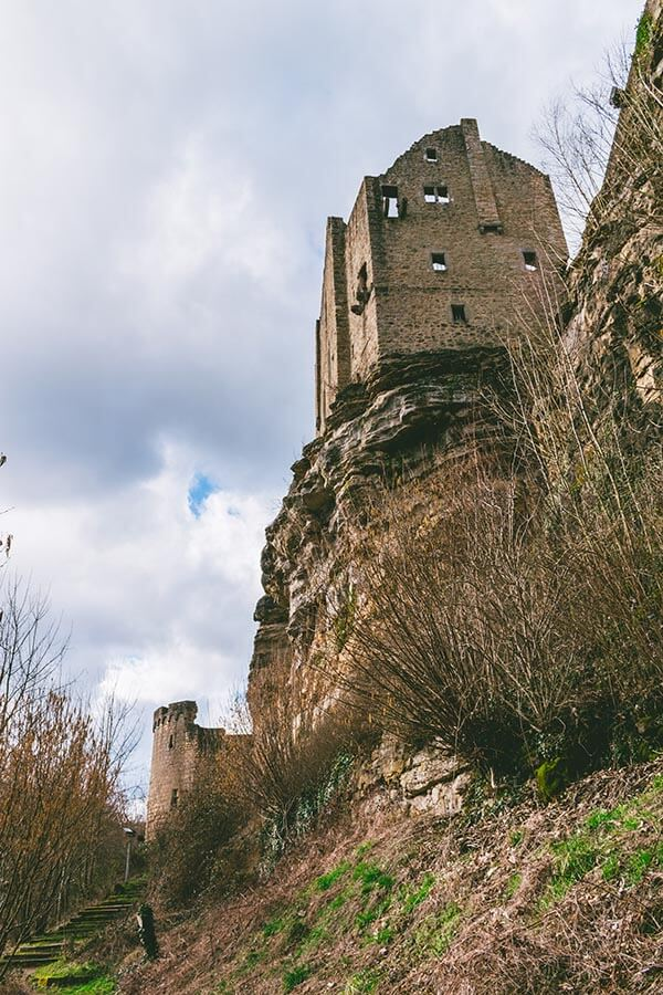 The stunning castle ruins of LaRochette Château in Luxembourg seen from the loop trail. #castle #Luxembourg