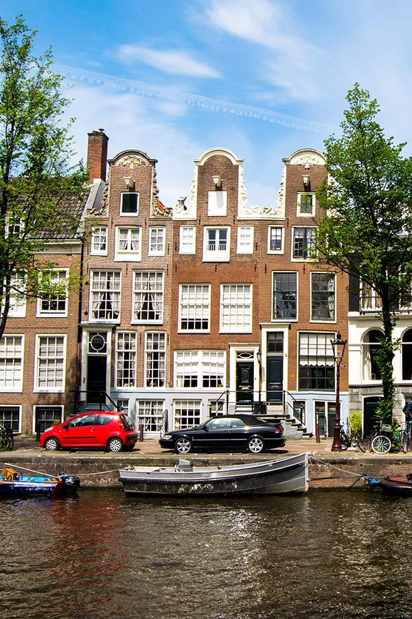 Picturesque Amsterdam canal in May, one of the best times of the year to visit Amsterdam!