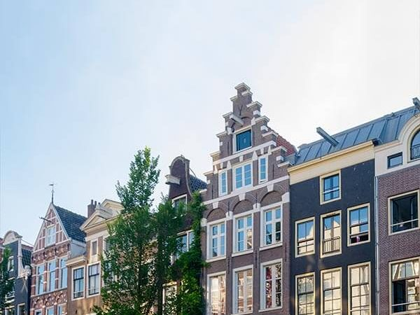 Beautiful daytime photo of the Red Light District in Amsterdam with coffeeshops and cafes.