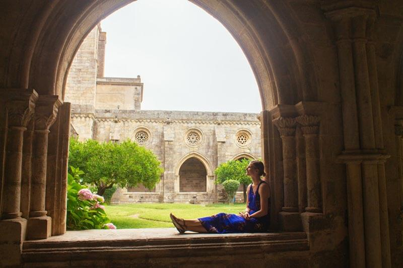 Girl enjoying a beautiful view of Evora, one of the weekend trips from Lisbon