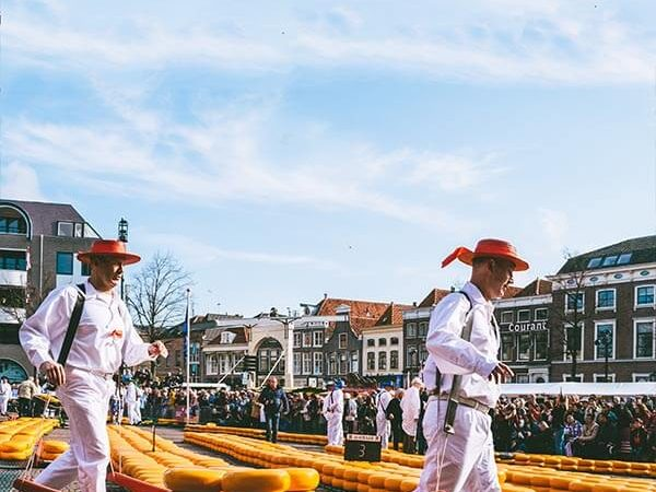 Two cheese carriers carrying cheese within the Alkmaar Cheese Market in Holland!