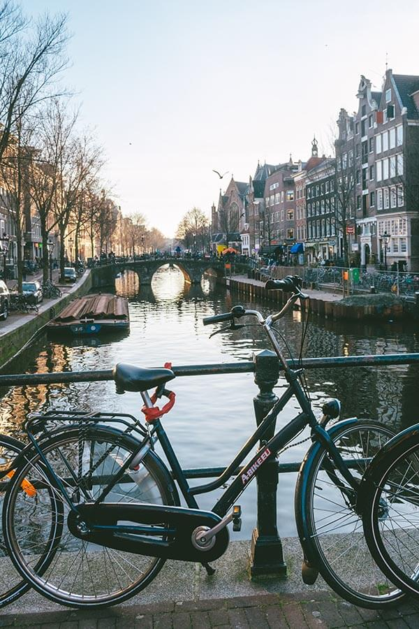Bicycle with beautiful view of Amsterdam, one of the highlights of Holland
