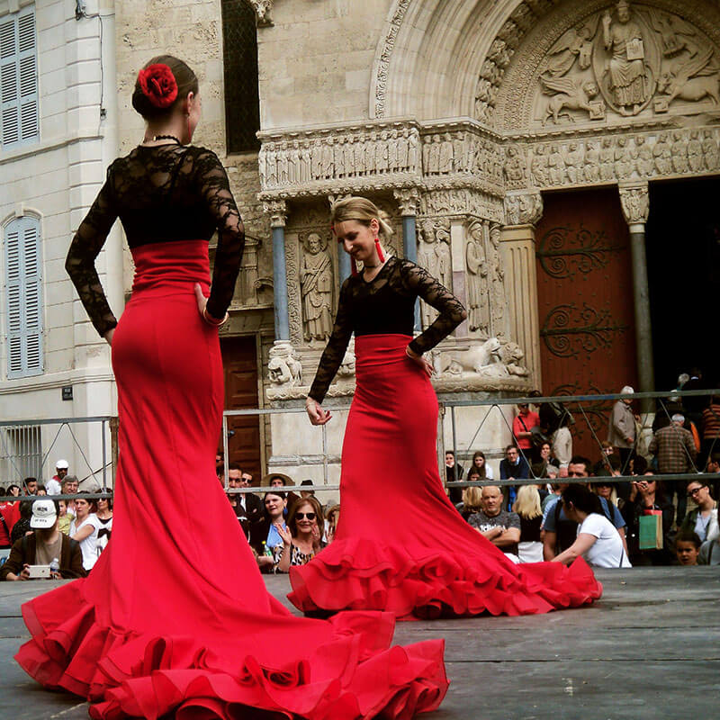 Flamenco dancers during Easter festivities in Arles, France.