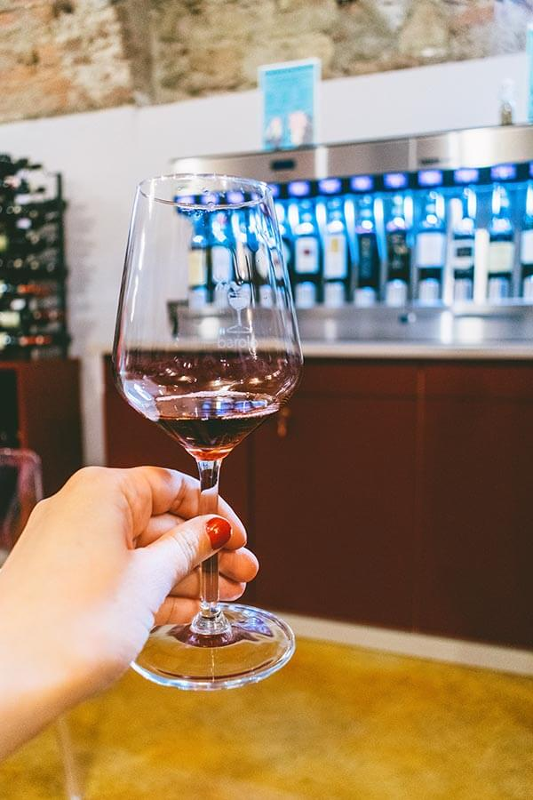 Glass of Barolo wine within a Barolo tasting room in Barolo, Italy!