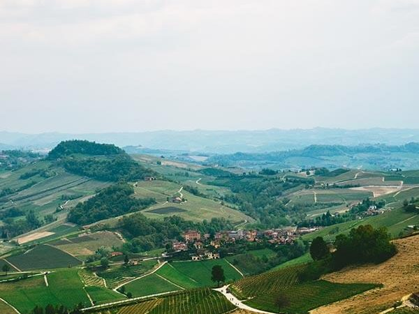 Beautiful landscape with vineyards surrounding Barolo, Italy seen during a self-guided wine tasting in Piedmont!