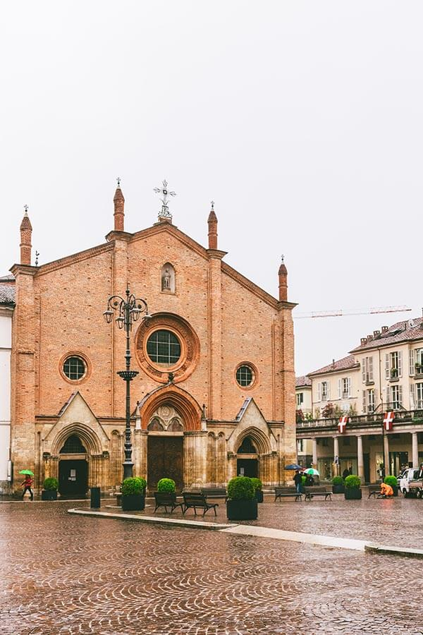 beautiful piazza with historic church in Asti, Italy