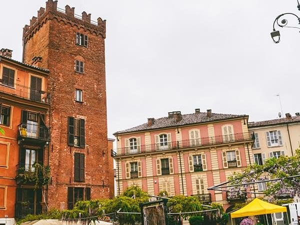 Beautiful piazza in Asti, Italy with wisteria and small brick tower!