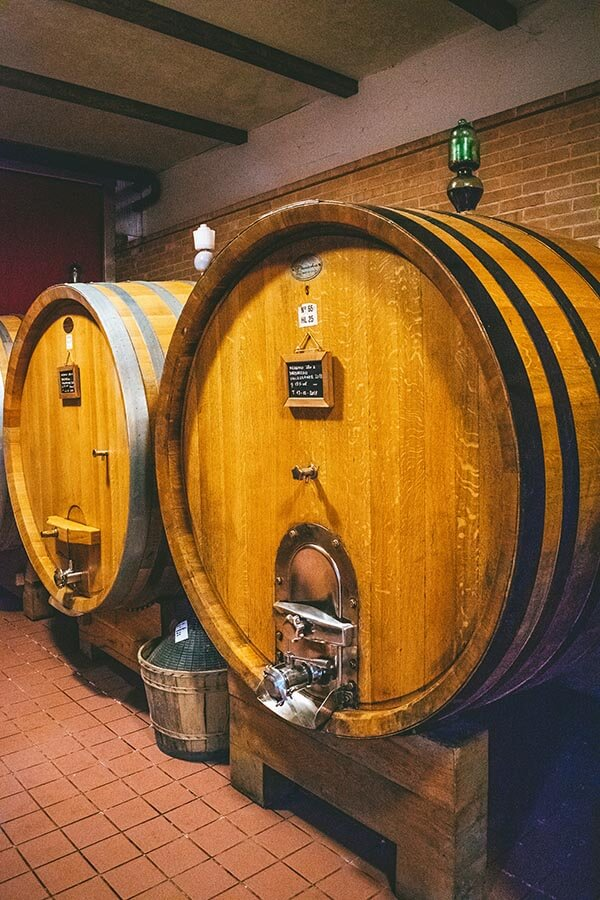 Wine barrel seen during a vineyard tour and tasting of a Piedmont winery producing Barbaresco