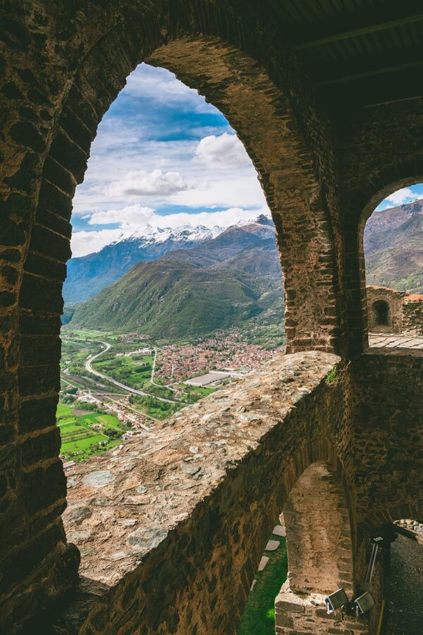 Beautiful view through supporting buttresses of the Alps from Sagra di San Michele, a beautiful 10th century abbey near Turin!