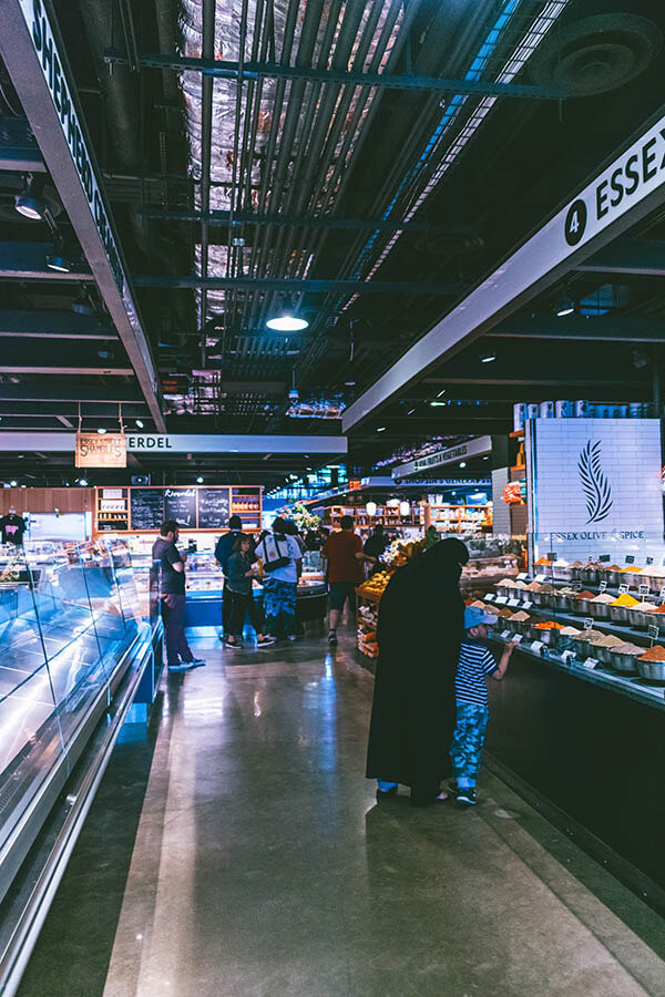 Interior of the new Essex Street Market with woman browsing