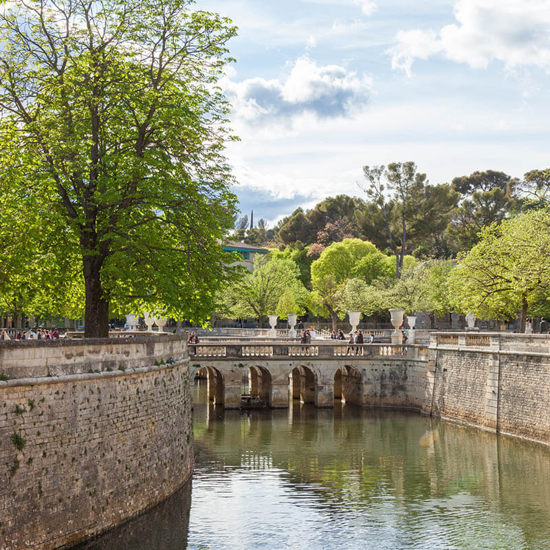 Fountain Garden in Nimes, France with reflection in the water