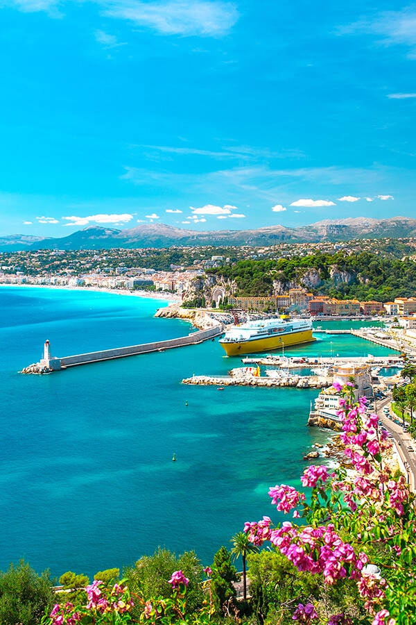 Beautiful views of Nice port with flowers in background