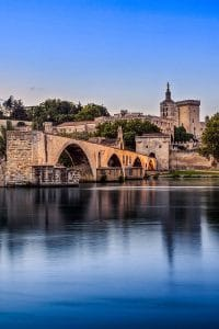 Beautiful photo of Avignon reflected in water with Palace of the Popes