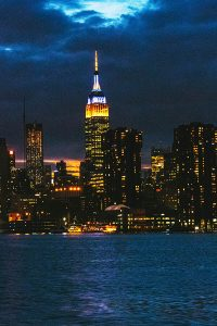 Empire State Building with skyline of New York after dusk