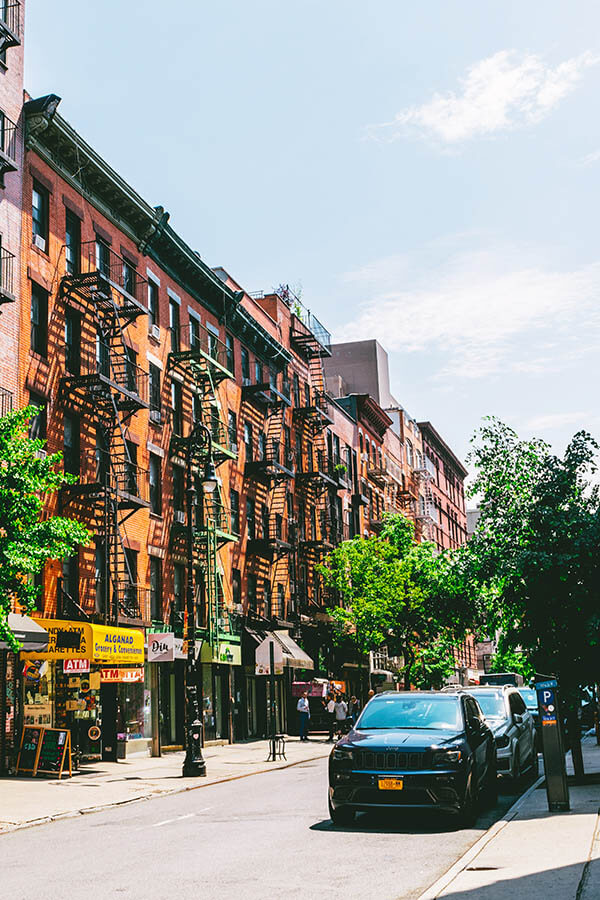 Colorful tenement style buildings in Lower Manhattan on quiet street