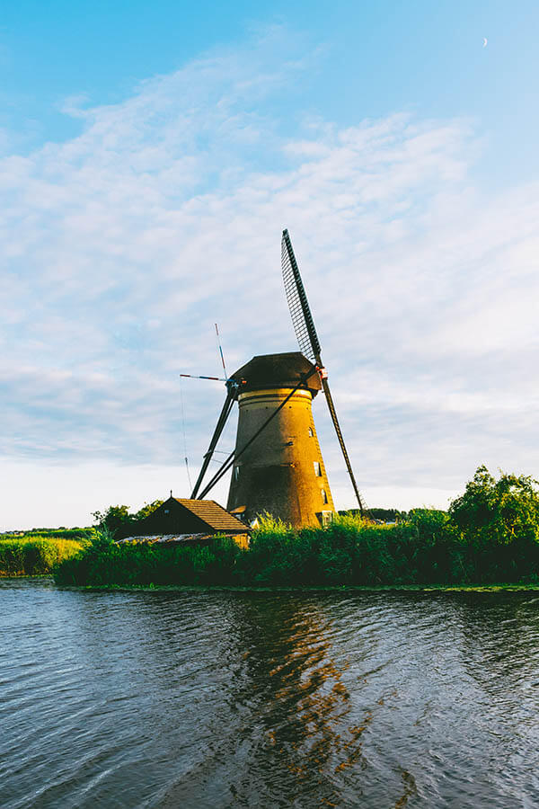 One of the windmills at Kinderdijk seen across canal