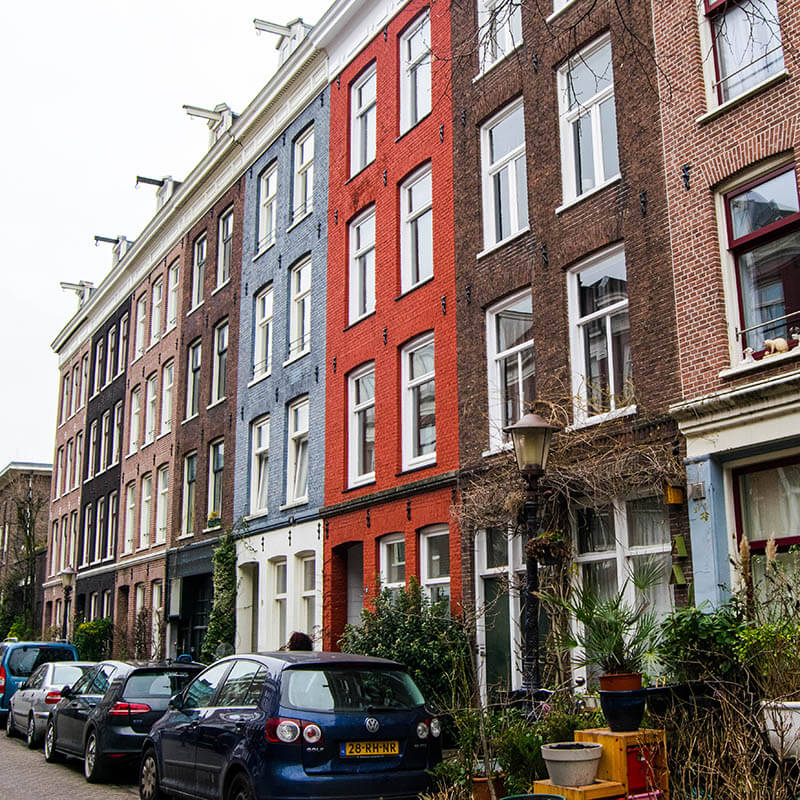 Beautiful colorful houses in De Pijp, one of the best neighborhoods to stay in Amsterdam