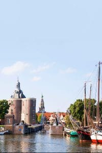 Picturesque view of Enkhuizen including the drommedaris and ships.