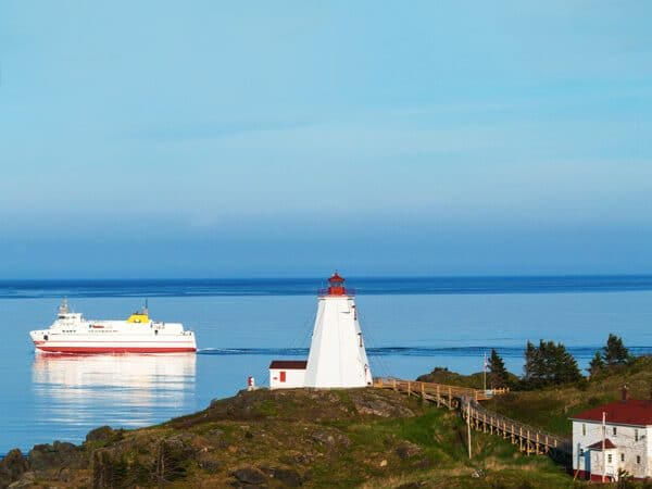 Beautiful lighthouse with ferry in distance on Grand Manan Island in New Brunswick, Canada!