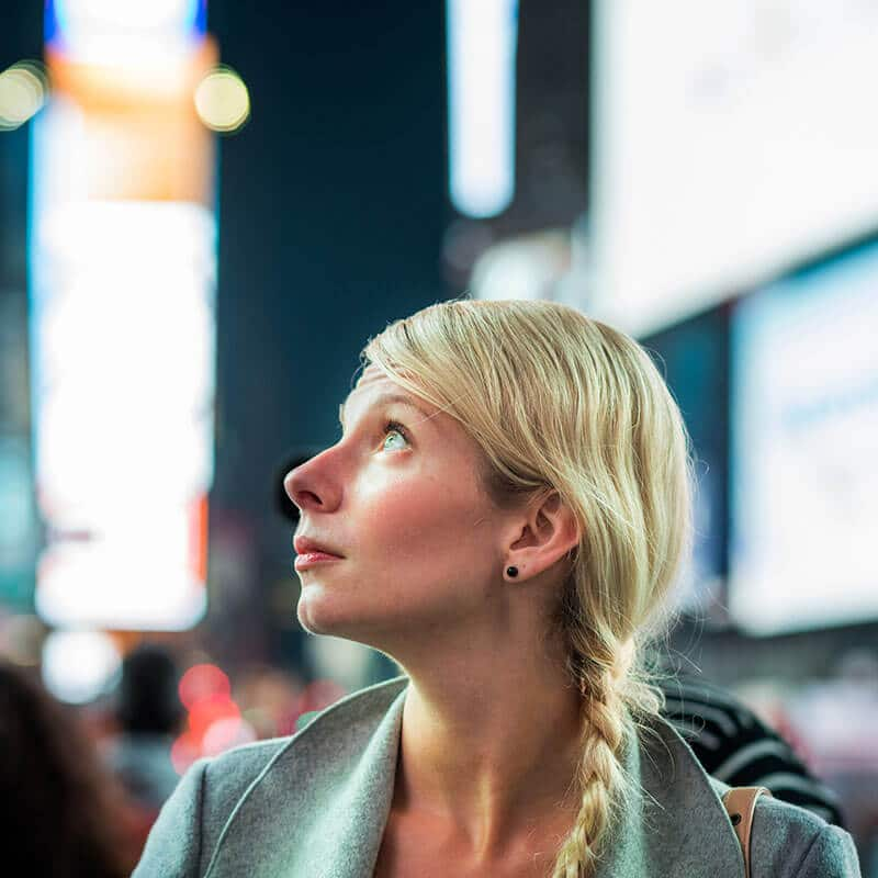 Girl enjoying Times Square at night