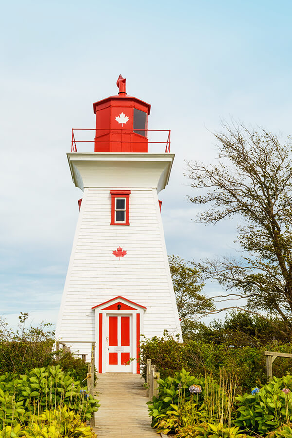 Beautiful red and white lighthouse in Victoria in Prince Edward Island