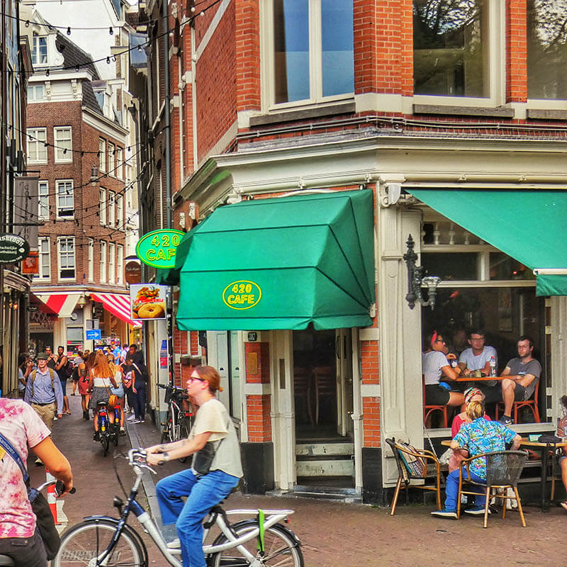Tourists enjoying cannabis at one of the best coffeeshops in Amsterdam