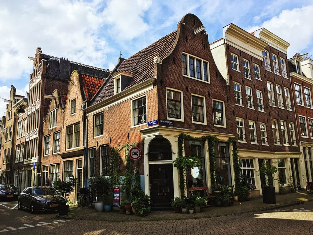 Beautiful traditional houses in De Jordaan, one of the most charming neighborhoods to stay in Amsterdam