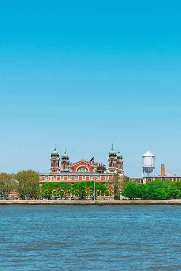 Ellis Island seen from the Statue of Liberty ferry on a beautiful sunny day.