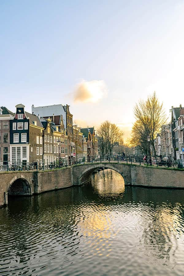 Beautiful sunset in Amsterdam Center, one of the best neighborhoods to stay in Amsterdam on a budget