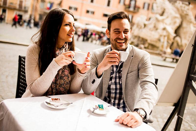 Couple enjoying an espresso in Rome Italy during their honeymoon
