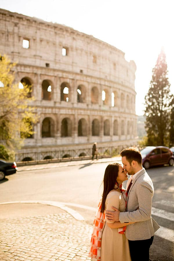 Newly married couple outside of the Roman Coliseum in Rome, Italy enjoying their honeymoon in Italy!