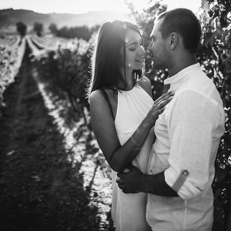 Couple enjoying a romantic vineyard visit during their honeymoon in Italy