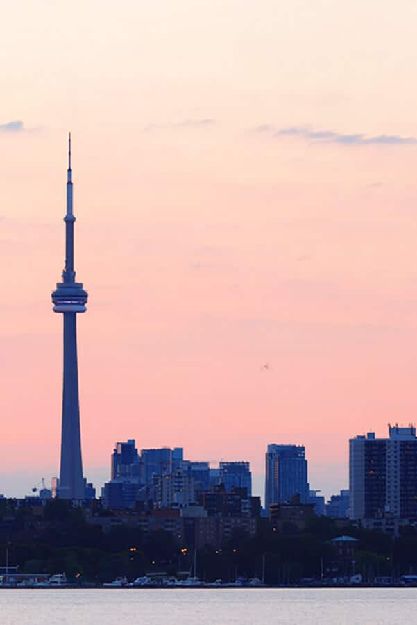 Beautiful sunset of Toronto skyline with CN Tower seen from Toronto Islands, one of the best things to do in Toronto!